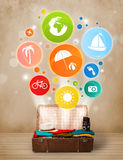 Suitcase with colorful summer icons and symbols Royalty Free Stock Images
