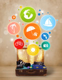 Suitcase with colorful summer icons and symbols Royalty Free Stock Photo