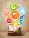 Suitcase with colorful summer icons and symbols. On grungy background Royalty Free Stock Photography