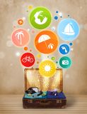 Suitcase with colorful summer icons and symbols. On grungy background Royalty Free Stock Image
