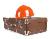 Suitcase and construction helmets Royalty Free Stock Photos