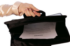 Suitcase with contracts Royalty Free Stock Photo
