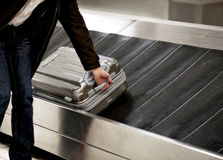 Suitcase on conveyor belt Stock Image