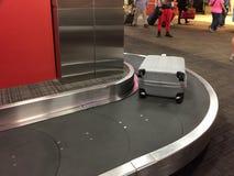 Suitcase on conveyor belt at airport. TX USA Stock Photos
