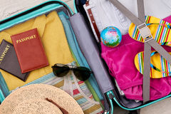 Suitcase with different traveler items. Packed luggage for family summer trip Royalty Free Stock Photography
