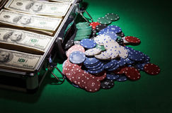 Suitcase with dollars and  casino chips near Royalty Free Stock Photos