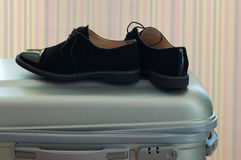 Suitcase with elegant black leather shoes Royalty Free Stock Image
