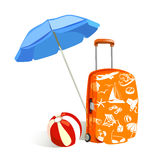 Suitcase with elements of travel and sun umbrella Stock Photography