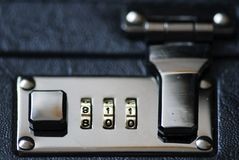 Suitcase fastener. Detailed admission of a suitcase fastener with figure code stock image
