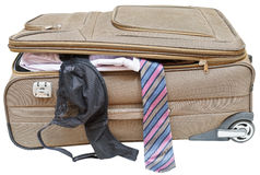 Suitcase with fell out male tie and female bra Stock Photo