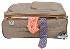 Suitcase with fell out male tie and female panties. Textile suitcase with fell out male tie and female panties isolated on white background Royalty Free Stock Photography