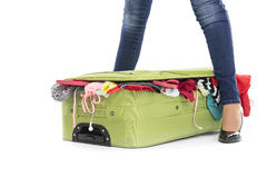 Suitcase between female legs. Royalty Free Stock Photo