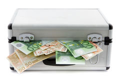 Suitcase filled with banknotes Royalty Free Stock Image