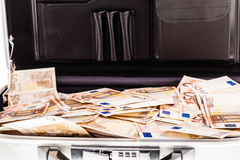 Suitcase filled with banknotes Royalty Free Stock Photos