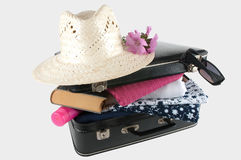 Suitcase filled for the holidays Royalty Free Stock Photo