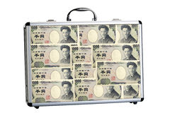 Suitcase filled with one thousand yen notes Royalty Free Stock Photo