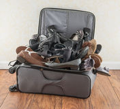 Suitcase Filled With Shoes Royalty Free Stock Photos