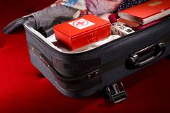 Suitcase with first-aid kit royalty free stock images