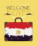 Suitcase with the flag of Egypt and planes Royalty Free Stock Photos