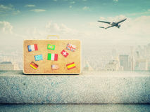 Suitcase with flag icons Royalty Free Stock Image