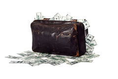 Suitcase full of banknotes. Ancient battered suitcase full of banknotes Stock Photos