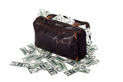 Suitcase full of banknotes. Ancient battered suitcase full of banknotes Royalty Free Stock Photo