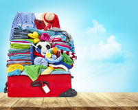 Suitcase Full Of Clothes, Open Luggage with Travel Baggage Royalty Free Stock Photography