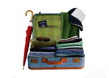 Suitcase with full of Clothes Royalty Free Stock Photography
