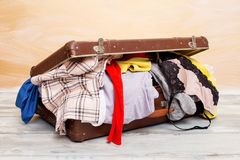 Suitcase full with clothes. For traveling Royalty Free Stock Images