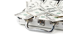 Suitcase full of dollars Royalty Free Stock Image
