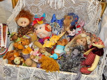 A suitcase full of dolls. Handicrafts. Collectible author's dolls at the 10th International Dolls Salon in Moscow in October, 2014 Royalty Free Stock Image