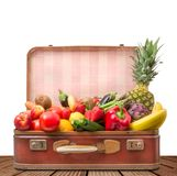 Suitcase full of fruit and vegetables stock images