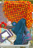 A suitcase full of handmade cases and rugs Stock Photos