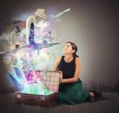 Suitcase full of memories. Traveler opens her suitcase full of memories Royalty Free Stock Photos