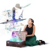 Suitcase full of memories. Traveler opens her suitcase full of memories Royalty Free Stock Image
