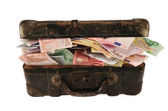Suitcase full of money royalty free stock photography