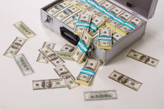 Suitcase full of money. Stock Images