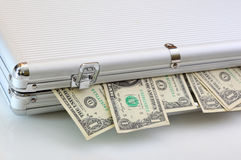 Suitcase full of money notes Stock Photo