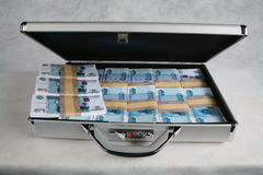 A suitcase full of money Royalty Free Stock Photo