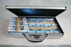 A suitcase full of money Stock Images