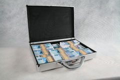 A suitcase full of money Stock Image
