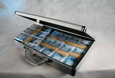 A suitcase full of money Stock Photo