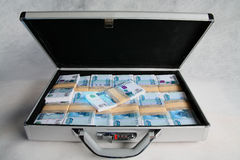 A suitcase full of money Stock Photos