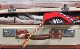 Suitcase full of warm clothes Royalty Free Stock Image