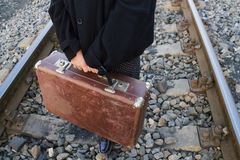 Suitcase in hand, traveling stock photo