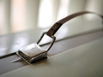 Vintage suitcase handle in light from window. stock images