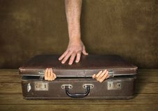 Suitcase and hands stock photography