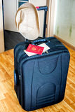 Suitcase, hat and documents for vacation Stock Photography