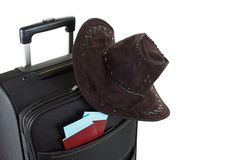 Suitcase with hat on it isolated against a white background. Travel concept Stock Photography