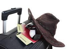 Suitcase with hat on it isolated against a white Royalty Free Stock Image